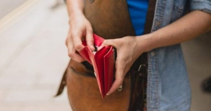 woman-opening-red-wallet_iStock_cropped-3097816624