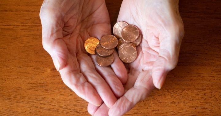 Close Up Of Elderly Woman's Hands Holding Pennies