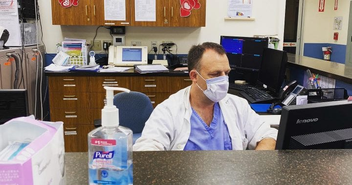 a doctor sits at a desk
