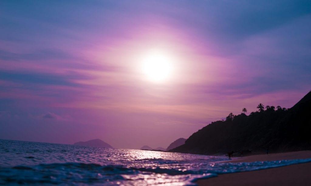 Super pink moon over the ocean.
