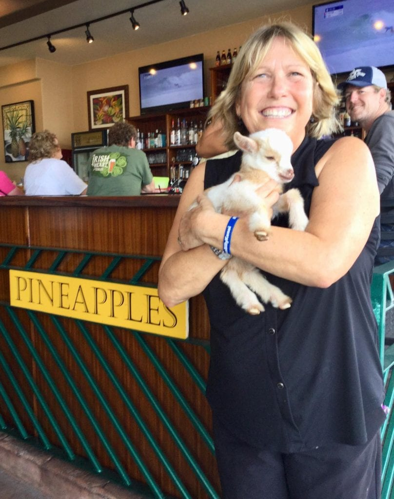 Organizer of Clean-Up Pamela Owens with Baby Goat outside of Pineapples Restaurant