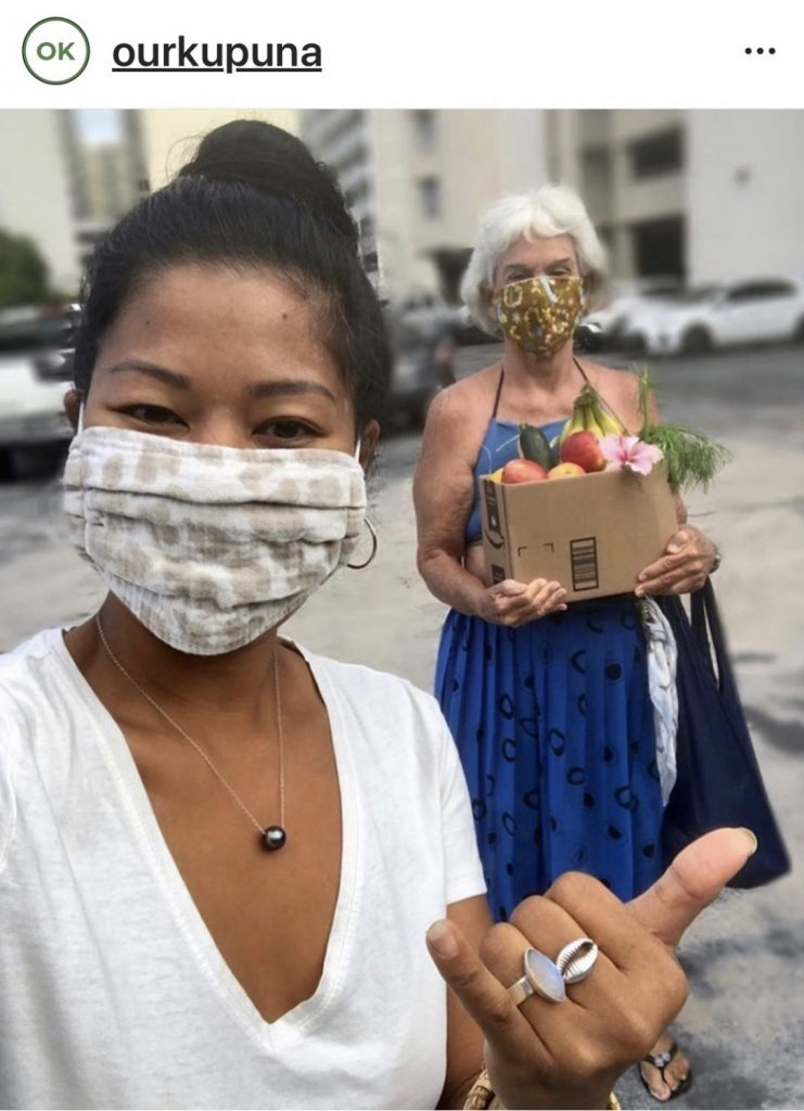 a young lady wearing a mask poses with a kupuna - volunteering for National Grandparents Day