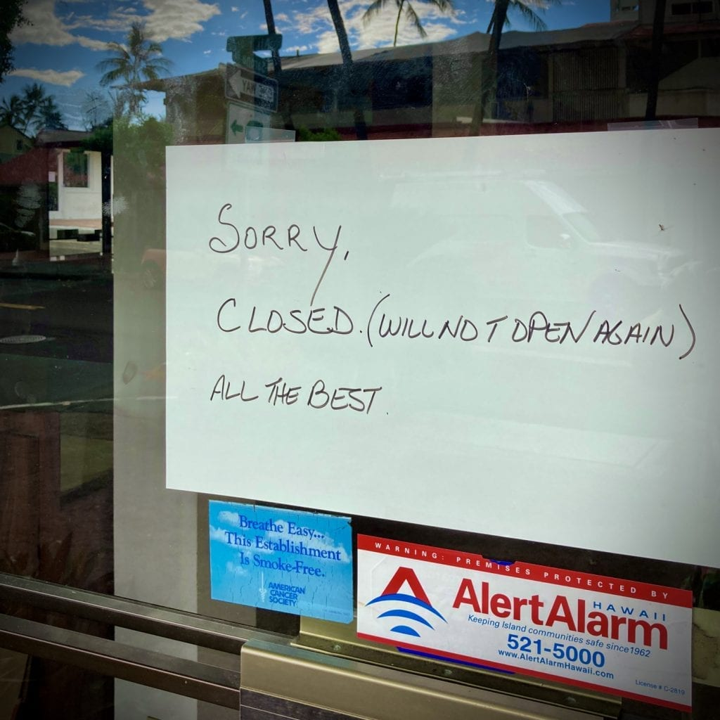 "a sign at one of Kona's small businesses reads ""sorry, closed (will not open again) all the best"