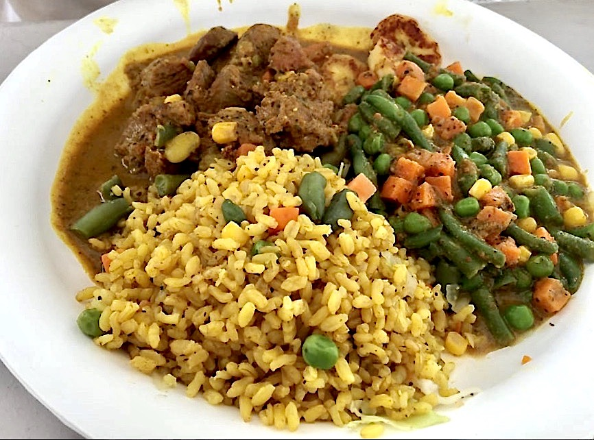 Curried lamb from Cool Runnings Food truck, on of the Big Island's best rice dishes