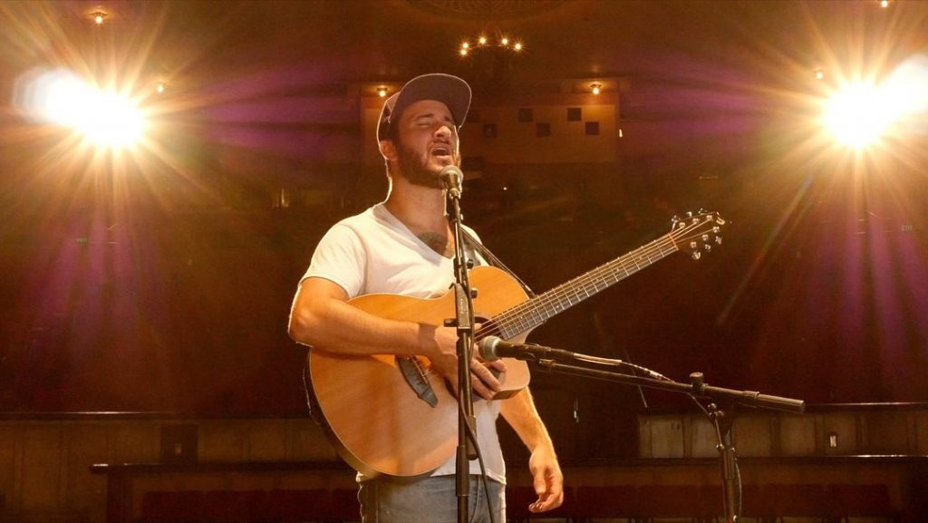Drew Daniels performs at the empty Palace Theater in Hilo