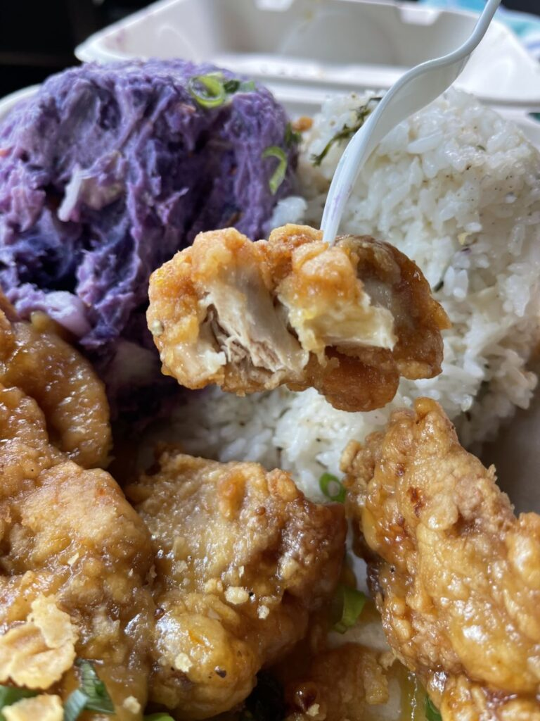 lilikoi chicken, purple potato salad, and a scoop of rice in a takeout container from Aloha Mondays