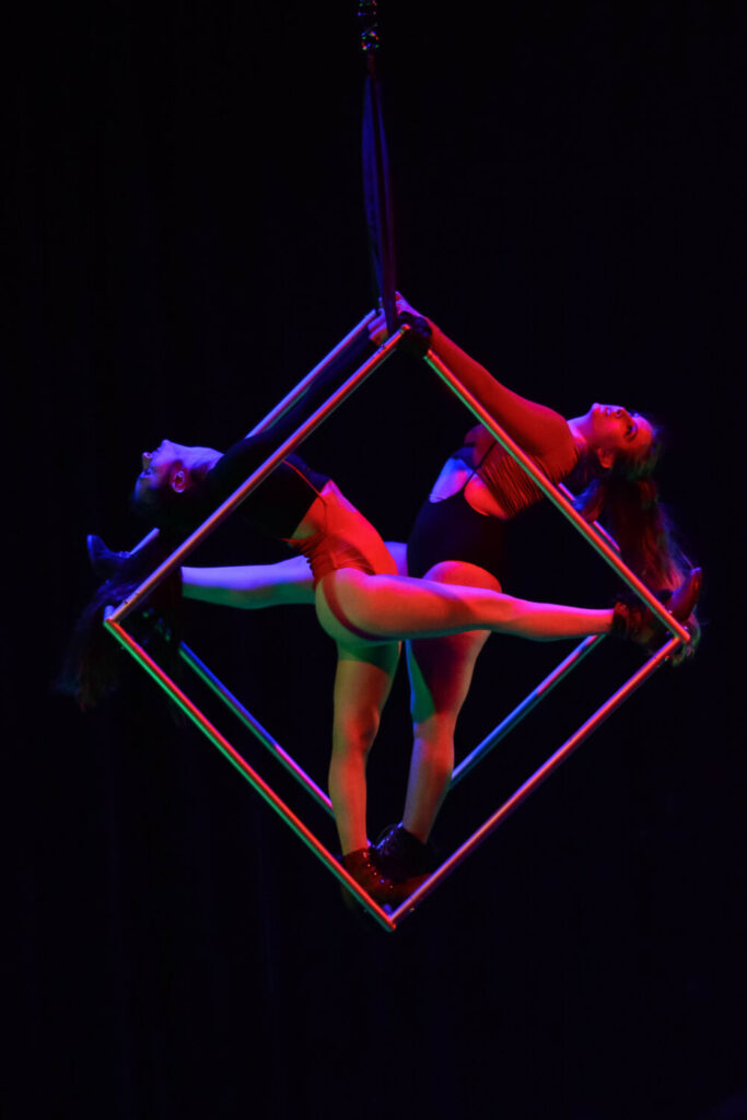 Two women hang in a cube at The Airhouse